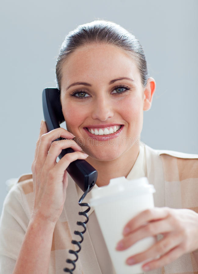 Caucasian Businesswoman On Phone Drinking A Coffee Royalty Free Stock Photo