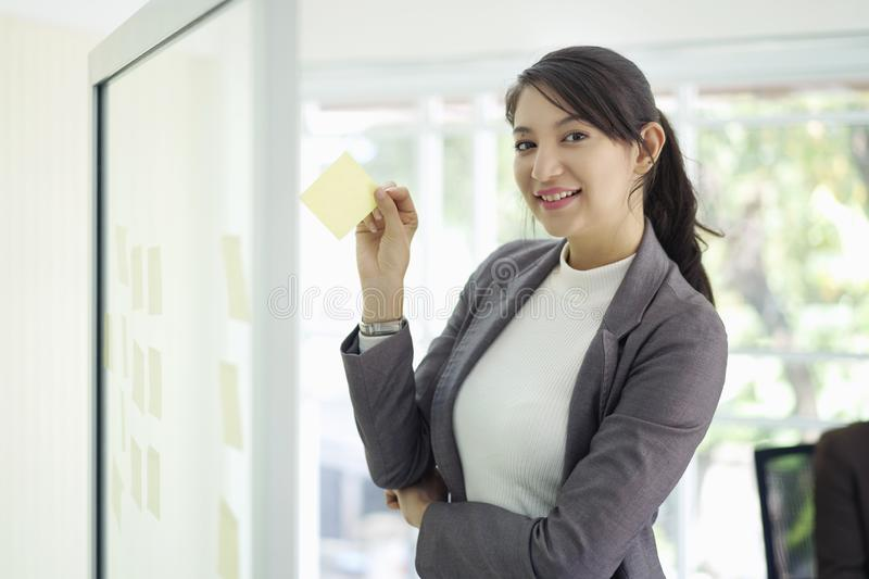 Caucasian businesswoman prepare brainstorm conference with paper note in meeting room office background, meeting successful royalty free stock image