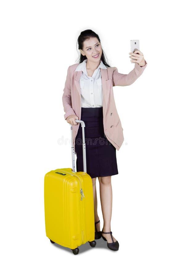 Caucasian businesswoman taking photo on studio stock photos