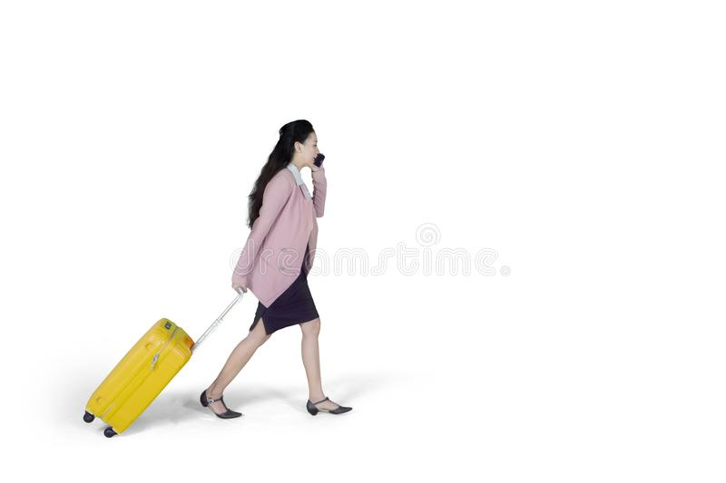Caucasian businesswoman walking with a suitcase stock photography