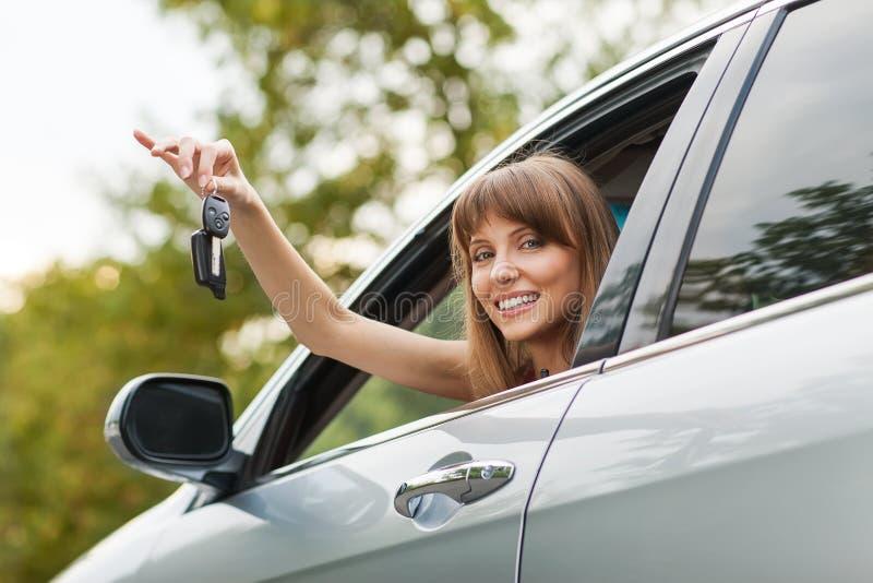 Caucasian car driver woman smiling royalty free stock image