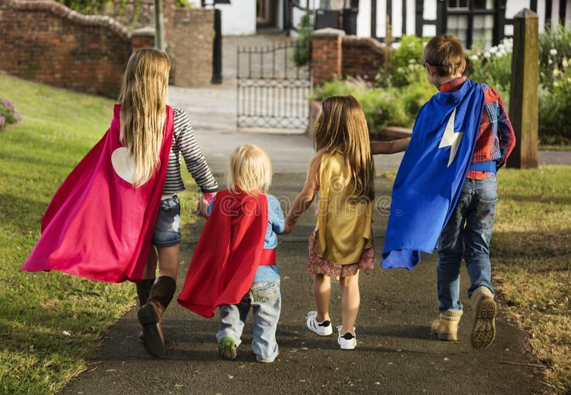 Caucasian children superhero and play shoot royalty free stock photography