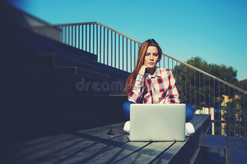 Caucasian college student studying with laptop computer at campus royalty free stock image