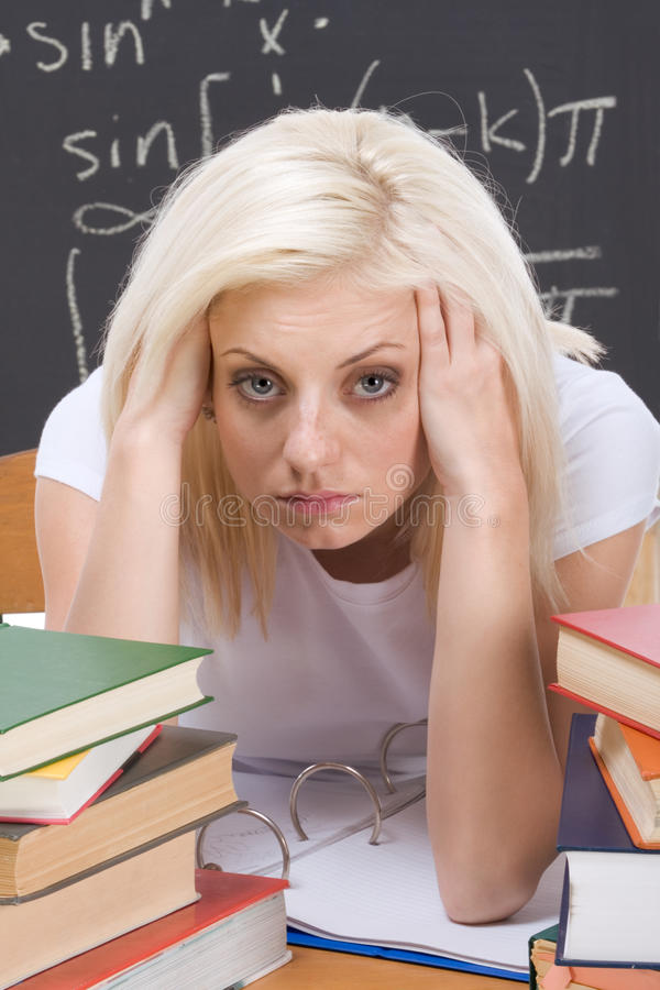 Caucasian college student woman studying math exam royalty free stock photography