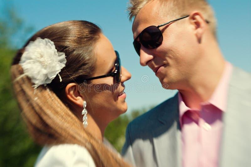 Caucasian couple with dark shades royalty free stock photo