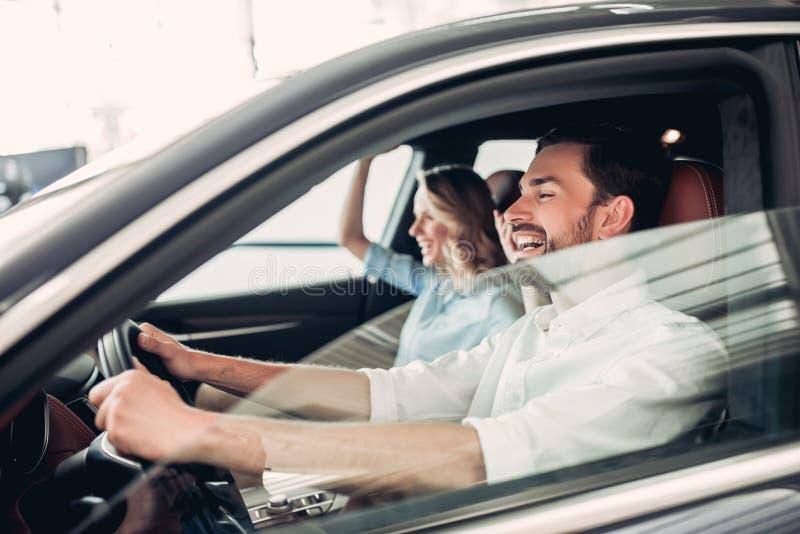 Caucasian couple driving new car stock photo