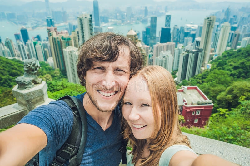 Caucasian couple in Hong Kong. Young people taking selfie picture at viewpoint of famous attraction Victoria Peak, HK, China stock photo