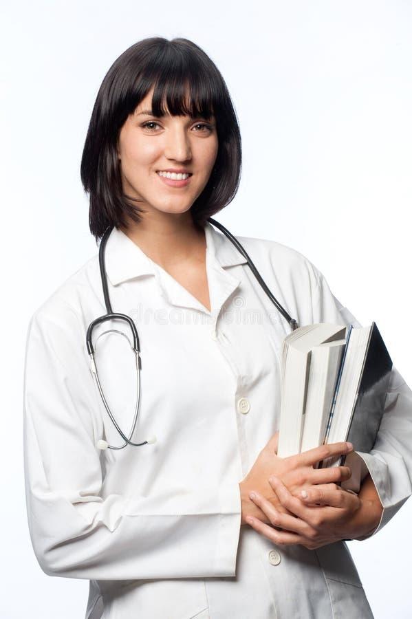 Caucasian doktor med böcker arkivfoton