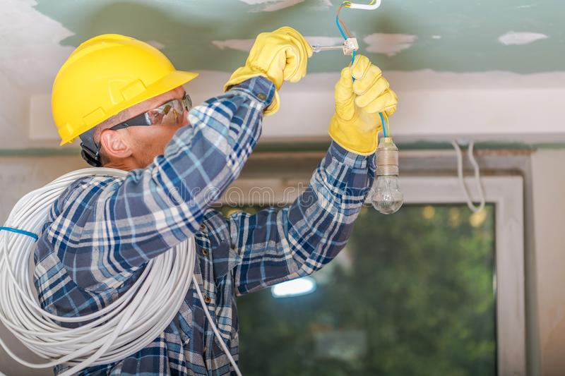 Caucasian Electrician at Work stock photos
