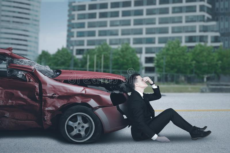 Caucasian entrepreneur and broken car royalty free stock photography