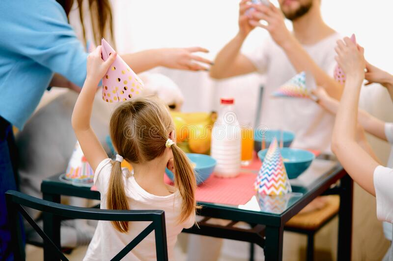 Caucasian family consisted of mother, father, children and dog celebrating birthday royalty free stock photography
