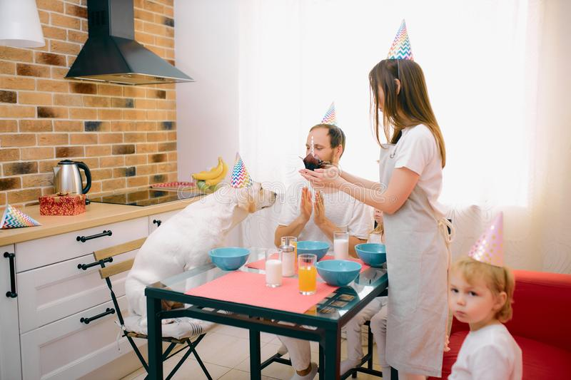 Caucasian family consisted of mother, father, children and dog celebrating birthday stock photo