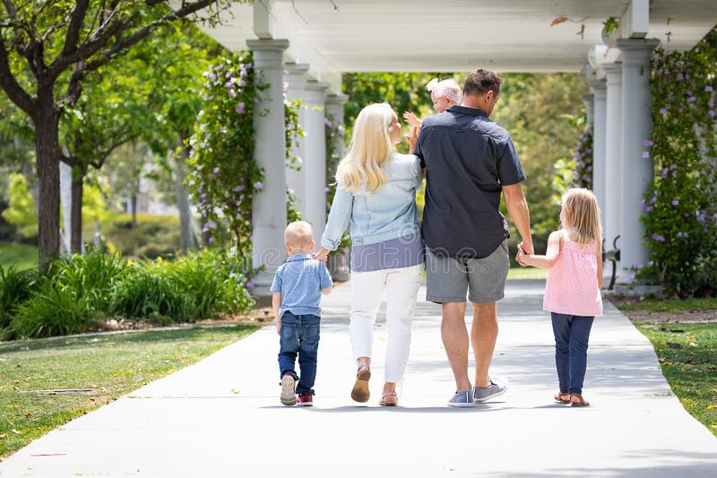 Caucasian Family of Five Taking A Walk In The Park stock photos