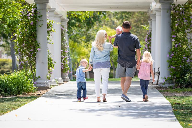 Caucasian Family of Five Taking A Walk In The Park stock photography
