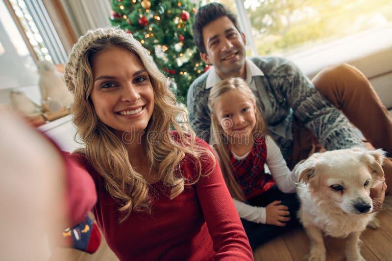 Caucasian family taking photos at Christmas stock photo