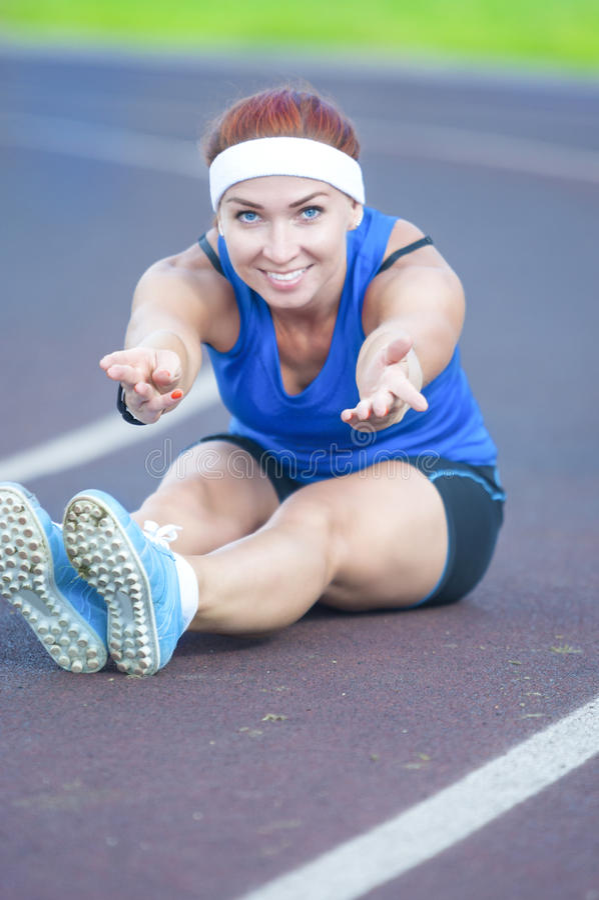 Caucasian Female Athlete During Body Stretching Exercises Outdoors stock photos