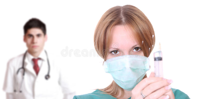 Caucasian female doctor. Medical team ready for injection over white background royalty free stock photo
