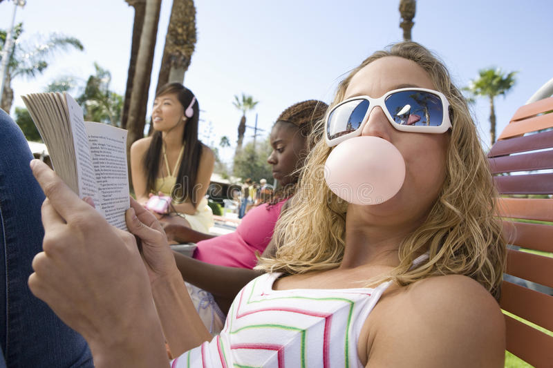 Caucasian Female Eating Chewing Gum stock photography