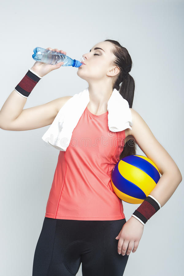 Caucasian Female Professional Volleyball Athlete Drinking and Ho royalty free stock photos