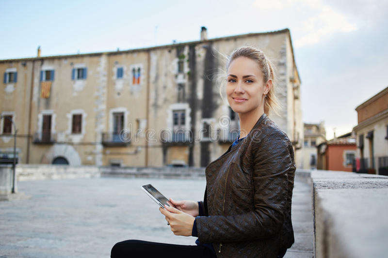 Caucasian female using touch pad during weekend in Rome stock photo