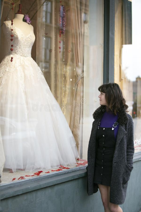 Woman Window Shopping for a Dress royalty free stock photos