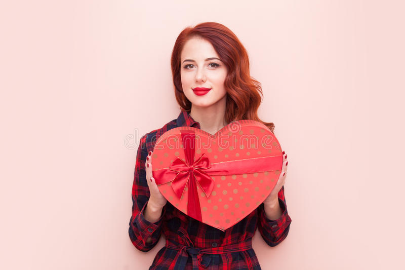 Caucasian girl with gift box stock photo