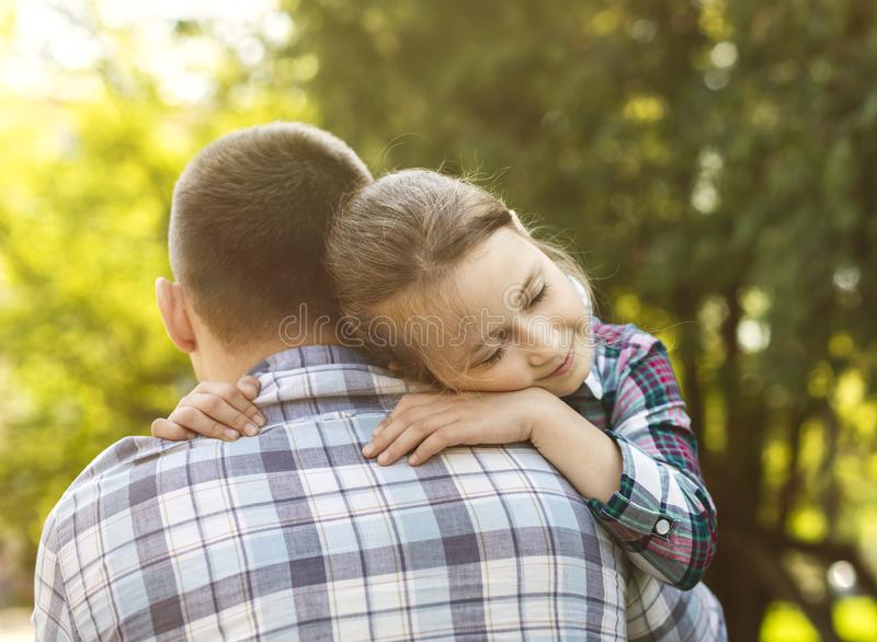 Beautiful girl embracing her father with love royalty free stock image