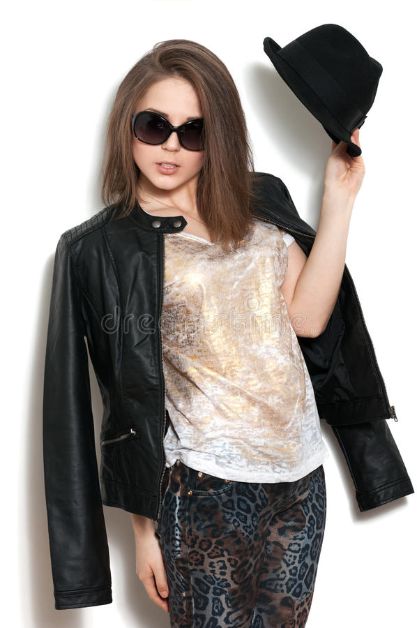 Girl In A Leather Jacket And Black Hat Stock Photography