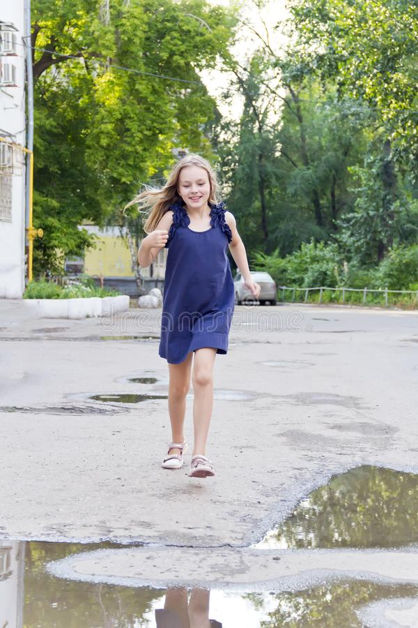 Caucasian girl run in summer with disheveled hair. Cute running European girl with disheveled hair royalty free stock photos