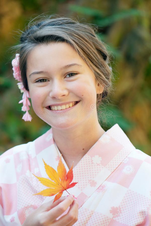 Caucasian girl wearing a kimono royalty free stock images