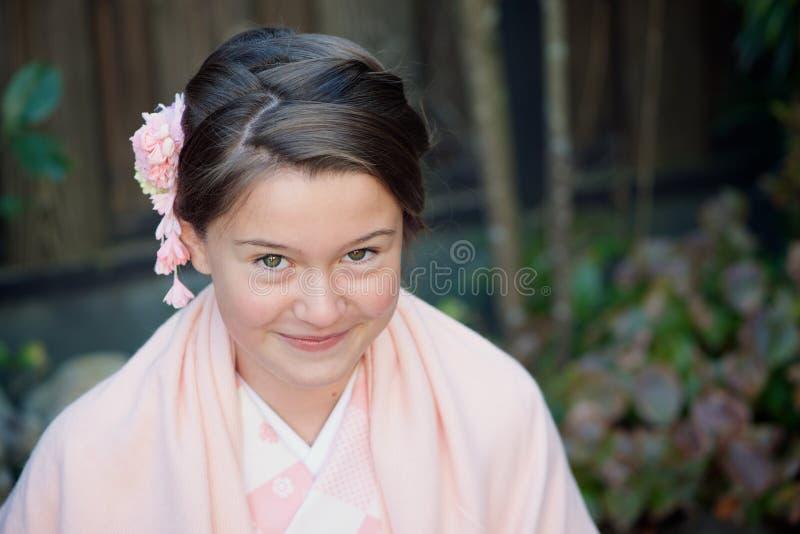 Caucasian girl wearing a traditional Japanese kimono stock photography