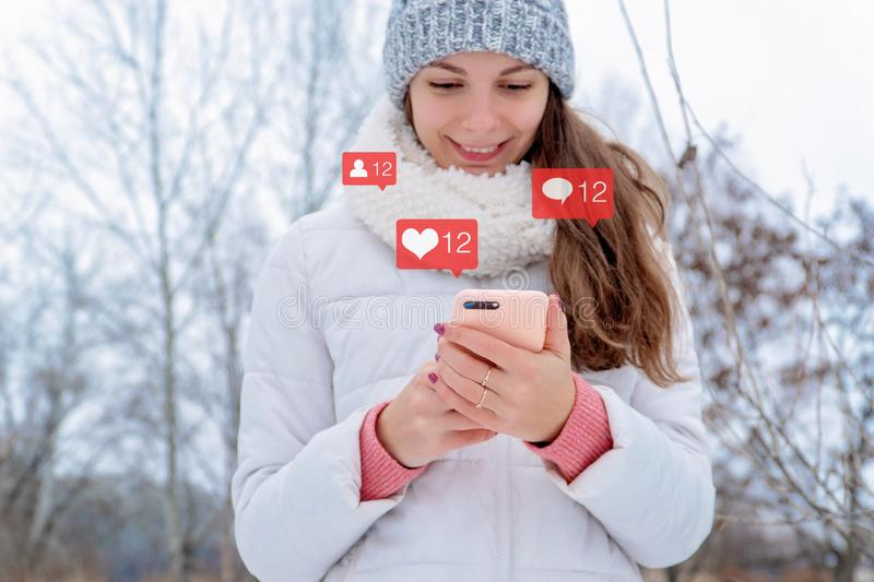 Caucasian girl woman holds phone instagram social media bloger icon followers likes comments addicted concept royalty free stock photos