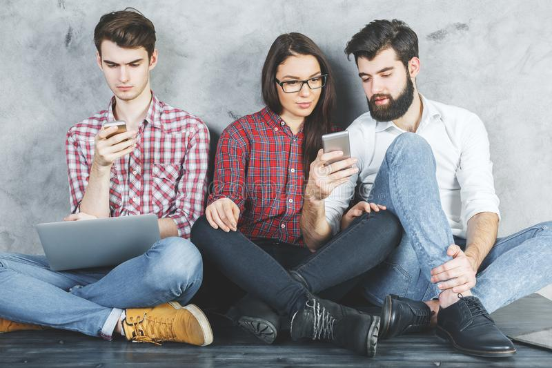 Caucasian group using devices royalty free stock photography