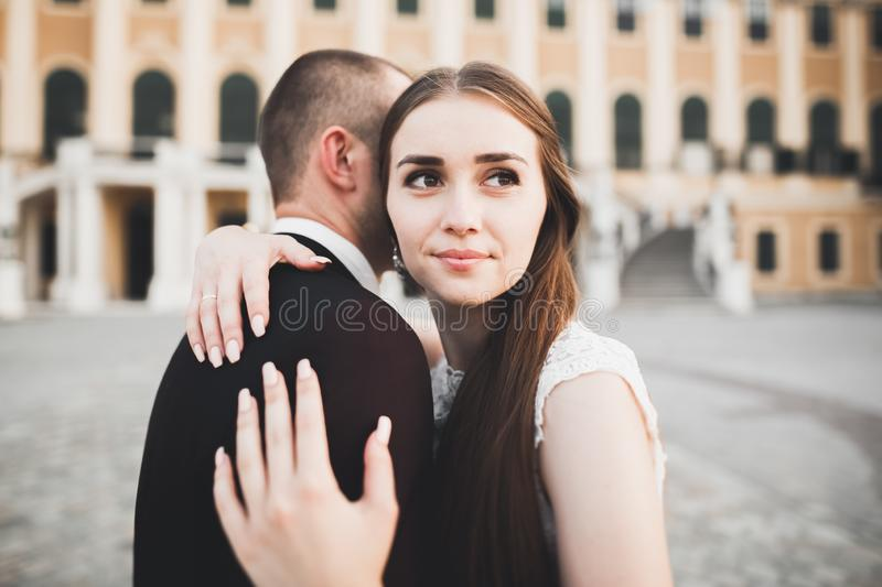 Caucasian happy romantic young couple celebrating their marriage. Outdoor stock images