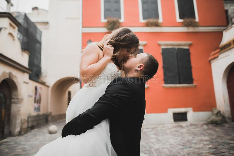 Caucasian happy romantic young couple celebrating their marriage. Outdoor stock photo
