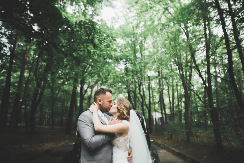 Caucasian happy romantic young couple celebrating their marriage. Outdoor stock photography