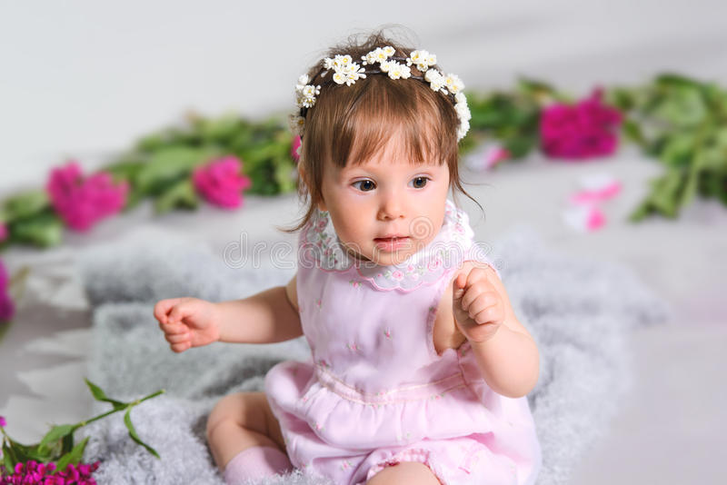 Caucasian happy a small child flower, grey background royalty free stock photos