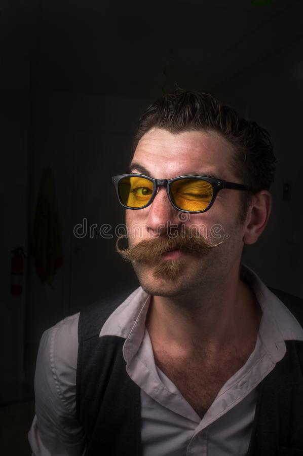 Caucasian Man Handlebar Mustache. Caucasian hipster man with large handlebar mustache wearing a dress shirt and suit vest stock images