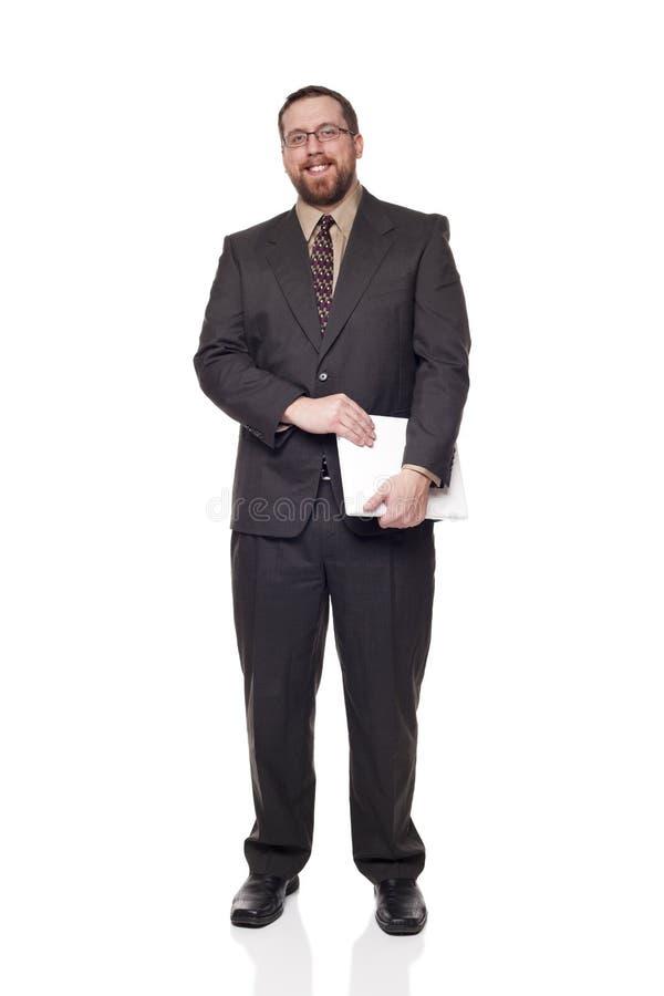 caucasian holdingbärbar dator för affärsman arkivfoto