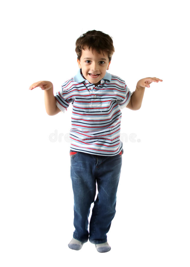 Caucasian kid looking to you with happy smile. A Brazilian and caucasian kid making a funny dance movemant with a happy and misterious smile on white background stock photography