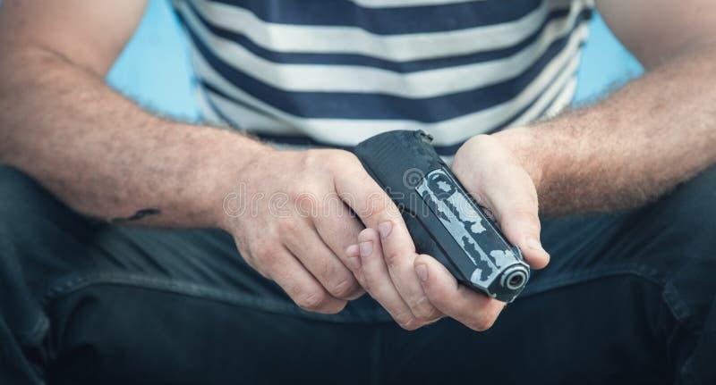 Caucasian killer with pistol. Criminal concept stock images