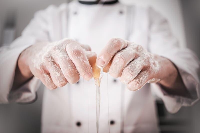Kitchen Chef Adding Egg stock images