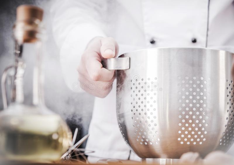 Kitchen Chef with Colander royalty free stock photos