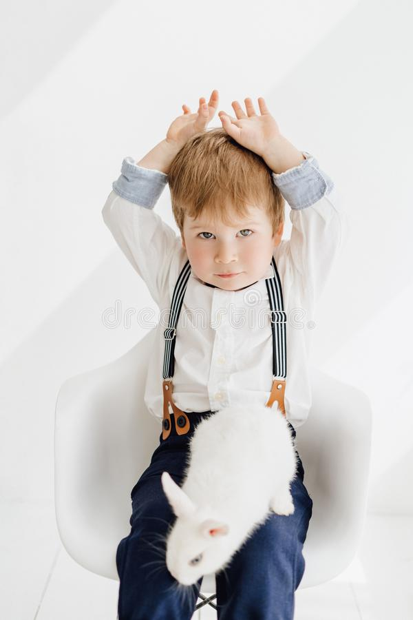 Caucasian Little Boy Playing with Easter Bunny royalty free stock photography