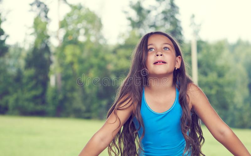 Caucasian little girl with long hair in swimsuit. Happy child royalty free stock images