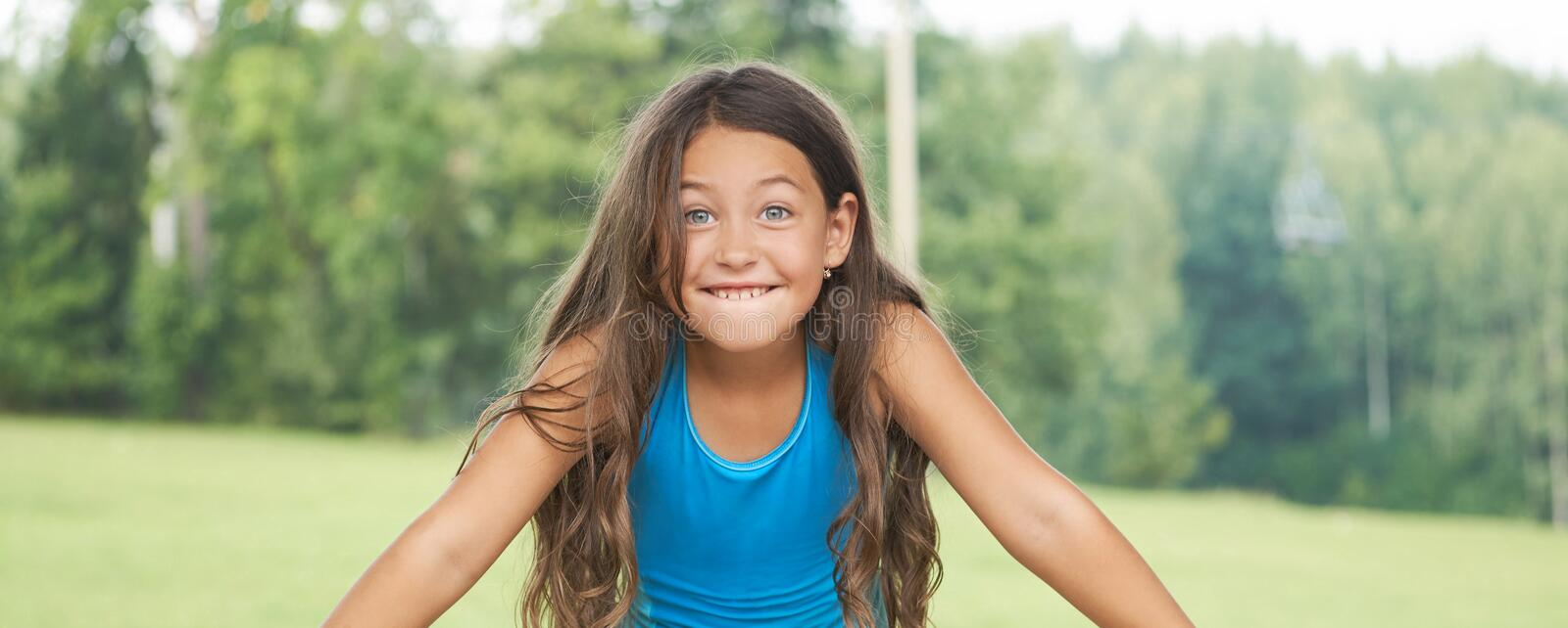 Caucasian little girl with long hair in swimsuit. Happy child stock photography