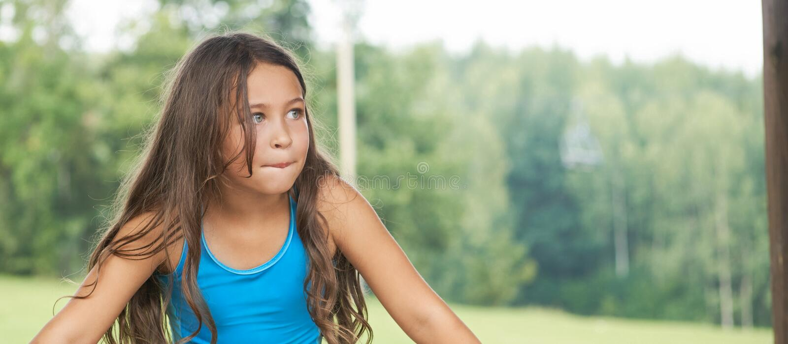 Caucasian little girl with long hair in swimsuit. Happy child royalty free stock photos