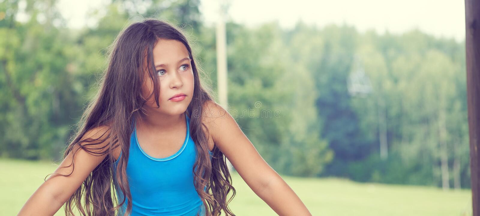 Caucasian little girl with long hair in swimsuit. Happy child stock photo