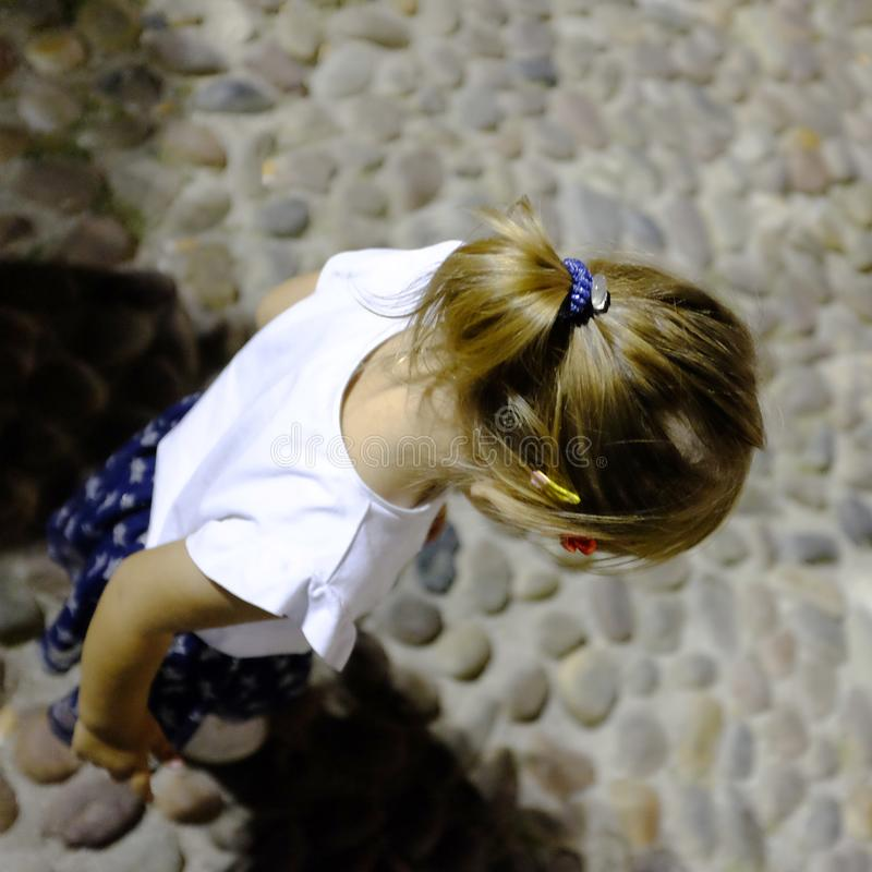 Caucasian little girl looking down. Abstract, baby, background, beautiful, beauty, black, blonde, brown, child, childhood, crying, cute, decoration, design stock images