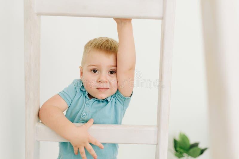 Caucasian little toddler boy climbing ladder royalty free stock images